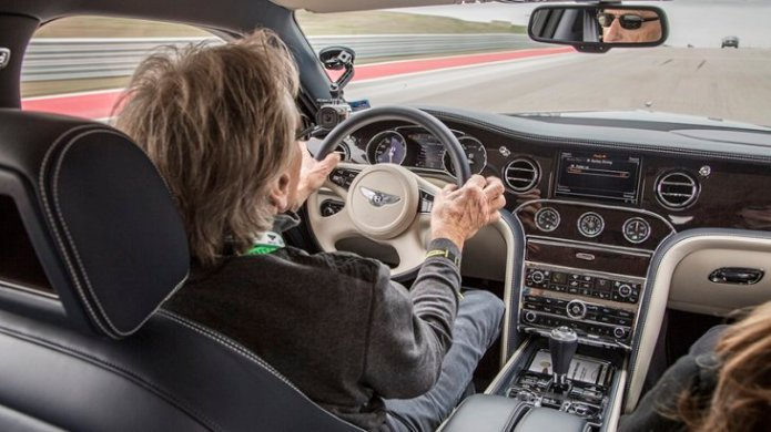 That's me sitting next to Derek Bell in the front seat of the Bentley Mulsanne Speed on COTA. Photo Courtesy of Bentley and Michael Shaffer.